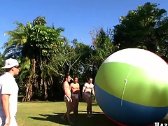 Great team work nearby four accurate muscular guys and giant ball, enjoy