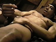 Muscled black trestle massages his big balls with the addition of strokes his strapping prick
