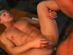 Muscled gay mechanics see to a hardcore threesome in the garage